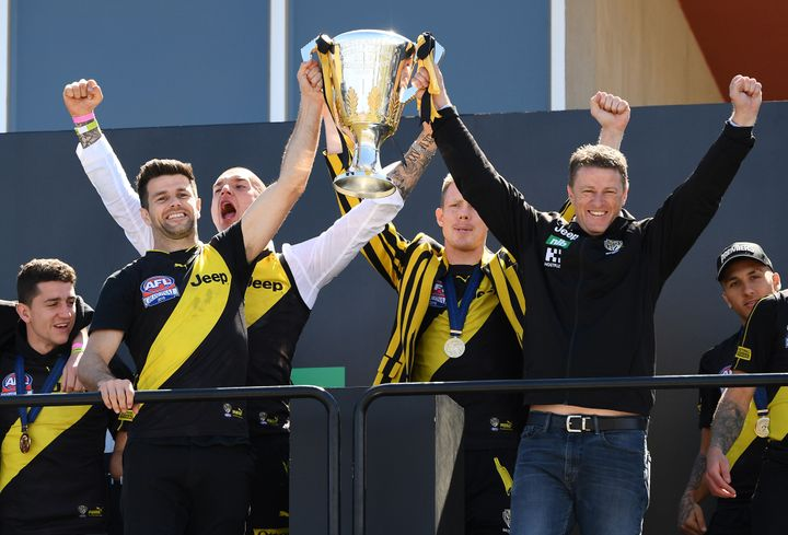 MELBOURNE, AUSTRALIA - SEPTEMBER 29: Tigers head coach Damien Hardwick and Trent Cotchin of the Tigers show the Premiership Trophy to the crowd during the Richmond Tigers Post AFL Grand Final Celebrations at Punt Road Oval on September 29, 2019 in Melbourne, Australia. The Richmond Tigers beat the Greater Western Sydney Giants in yesterday's AFL Grand Final. (Photo by Quinn Rooney/Getty Images)