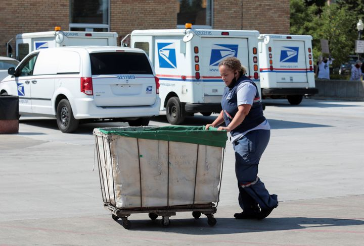 The Trump administration's takeover of the U.S. Postal Service has led to increasing delays as record numbers of voters are e
