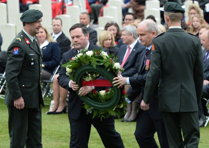 Then-Minister of Defence Jason Kenney and then-Minister of Veterans Affairs Erin O'Toole place a wreath during a commemorative ceremony at Holten Canadian War Cemetery in Holten, Netherlands, on May 4, 2015.