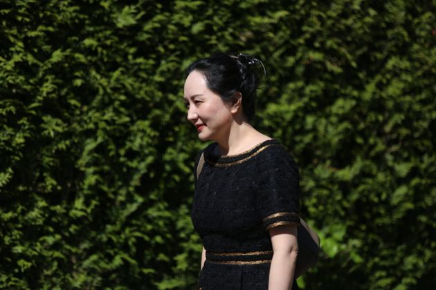 Meng Wanzhou, CFO of Huawei, walks down her driveway to her car as she departs her home for BC Supreme...
