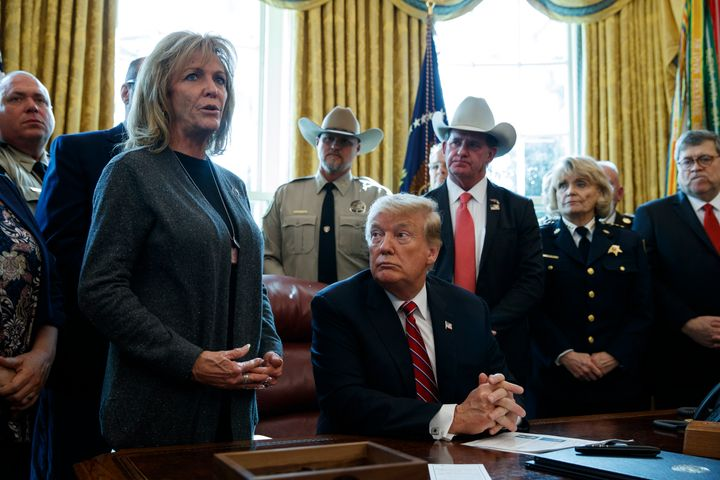 President Donald Trump listens to Mary Ann Mendoza in the Oval Office on March 15, 2019.