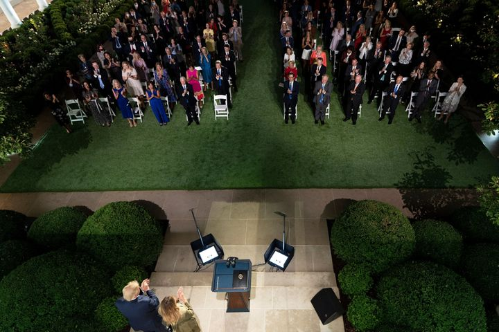 Masks? The crowd gathered at the White House to hear first lady Melania Trump's speech didn't need no stinkin' masks, e