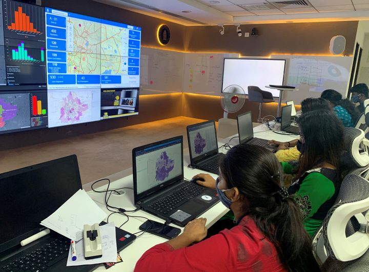 """Software professionals assisting municipal authorities work on their terminals inside a """"war room"""" focused on tracking the spread of the coronavirus disease at the Bruhat Bengaluru Mahanagara Palike office in Bengaluru on July 2, 2020."""