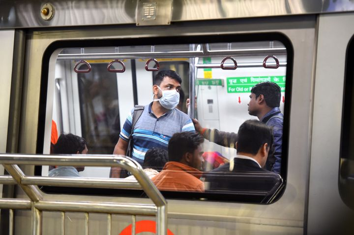Commuters seen at Rajiv Chowk Metro Station on March 13, 2020 in New Delhi.