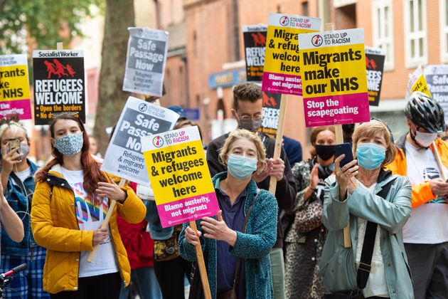 Campaigners protest outside the Home Office in central London on Tuesday to demand safe passage for migrants across the English Channel.