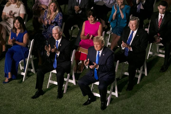 President Donald Trump and Vice President Mike Pence sit in the audience during Melania Trump's Republican National Con
