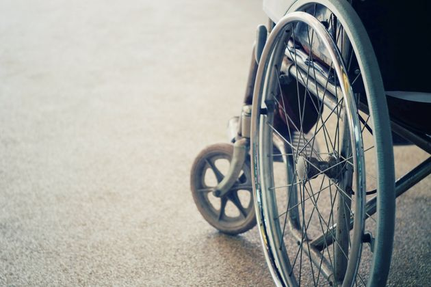Close-Up Of Wheelchair On