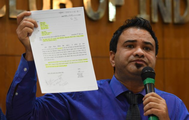 Dr. Kafeel Khan shows a document during a press conference at Press Club on September 28, 2019 in New...