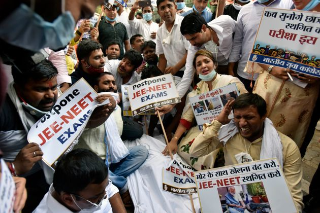 India Youth Congress activists protest as they demand the postponement of NEET and JEE entrance exam,...