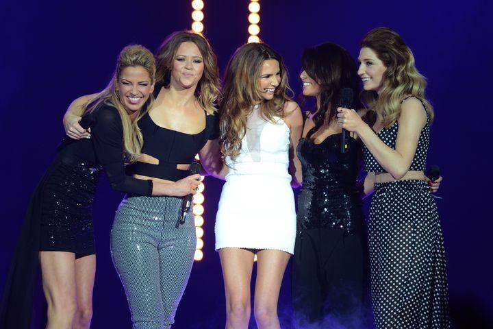 Girls Aloud on stage in 2012 (L-R) Sarah Harding, Kimberley Walsh, Nadine Coyle, Cheryl and Nicola Roberts.