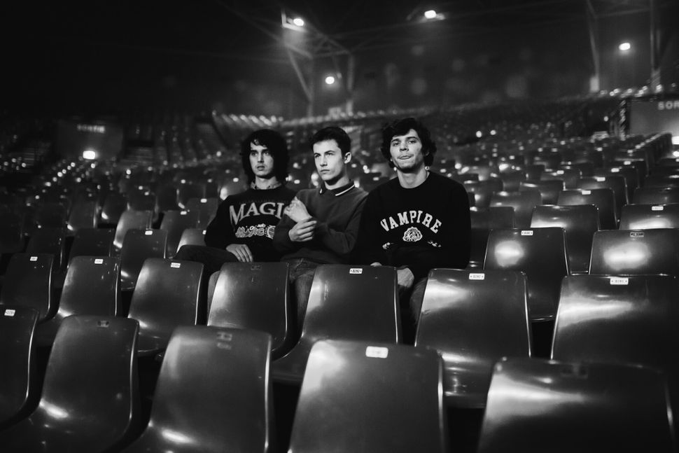 Wallows band members Cole Preston, Dylan Minnette and Braeden Lemasters in an empty theater.