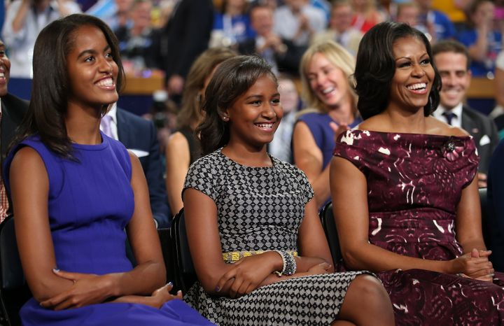 Malia, Sasha and Michelle Obama listen as then-President Barack Obama speaks at the Democratic National Convention in 2012.