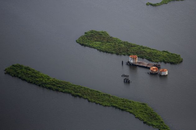 Old oil tanks are seen in an area affected by Hurricane Katrina on the Mississippi River