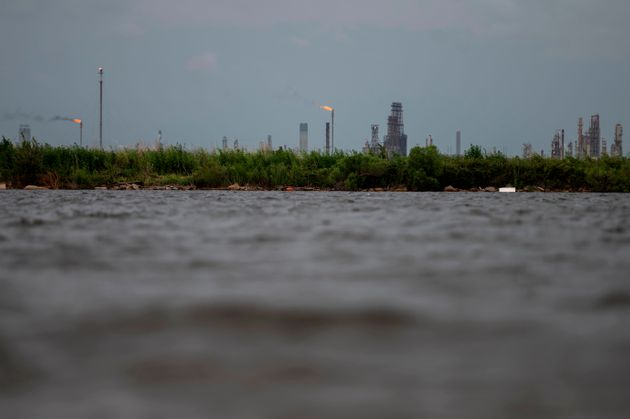 An oil and gas plant is seen across the Bayou Contraband as the water starts to rise before the arrival...