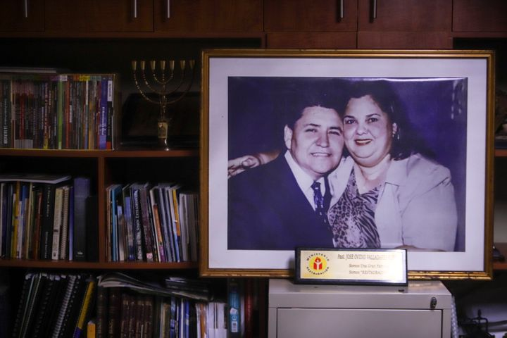 A portrait of Pastor Ovidio Valladares and his wife Aura Maria Valladares is displayed in his office at Bethel evangelical ch