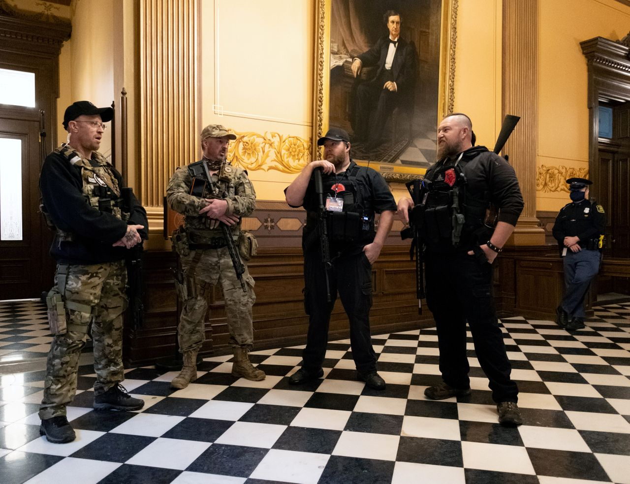Armed members of a militia group gather at Michigan's Capitol building in April ahead of a vote on the extension of Gov. Gretchen Whitmer's emergency declaration/stay-at-home order due to the coronavirus.