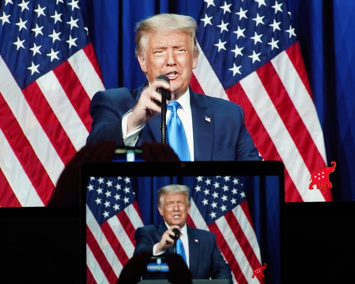 Screens display President Donald Trump speaking Monday during the 2020 Republican National Convention, after he was nominated