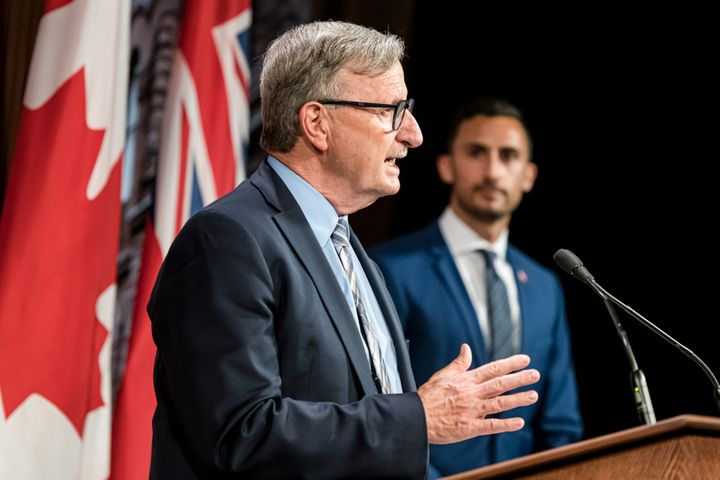 Dr. David Williams, Chief Medical Officer of Health for Ontario and Minister of Education, Stephen Lecce, make an announcement at Queen's Park in Toronto, on Aug, 13.