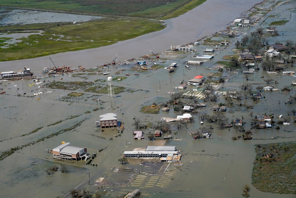 Buildings and homes in Cameron, Louisiana were flooded in the aftermath of Hurricane Laura on Thursday.