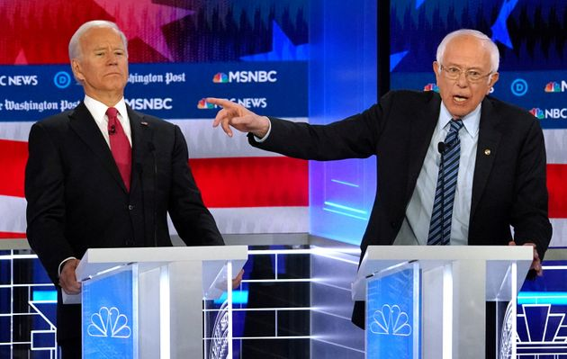 Sen. Bernie Sanders (I-Vt.), right, criticized Joe Biden for signing off on trade deals that cost the...