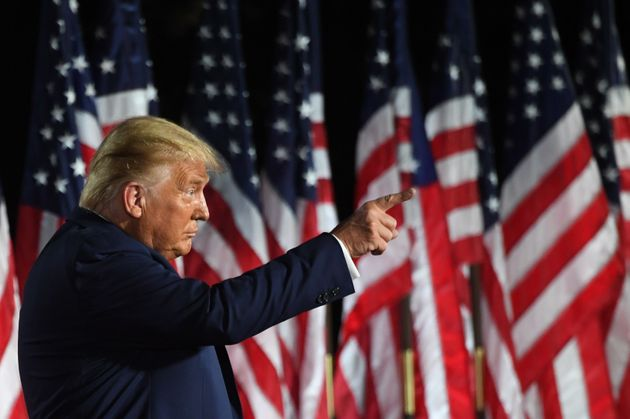 US President Donald Trump gestures at the conclusion of the the final day of the Republican National...