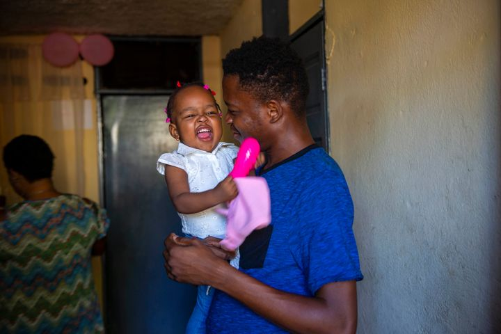 Verty holds up his 1-year-old daughter at his house in Port-au-Prince, Haiti, on Aug. 25, 2020. Verty says government contrac