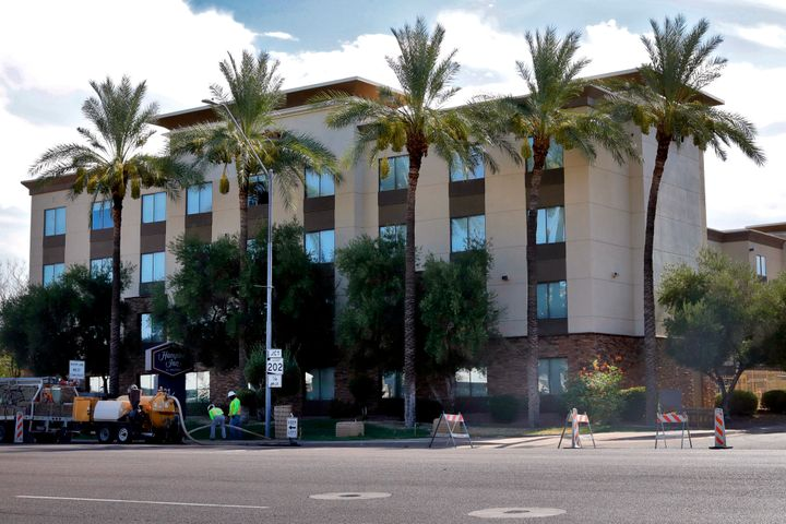 A Hampton Inn is shown Tuesday, July 21, 2020 in Phoenix. Documents obtained by The Associated Press show a private contracto
