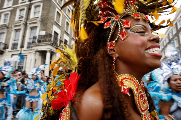 A performer dances in the street parade at the annual Notting Hill Carnival in central London, August 25, 2008. REUTERS/Suzanne Plunkett (BRITAIN)