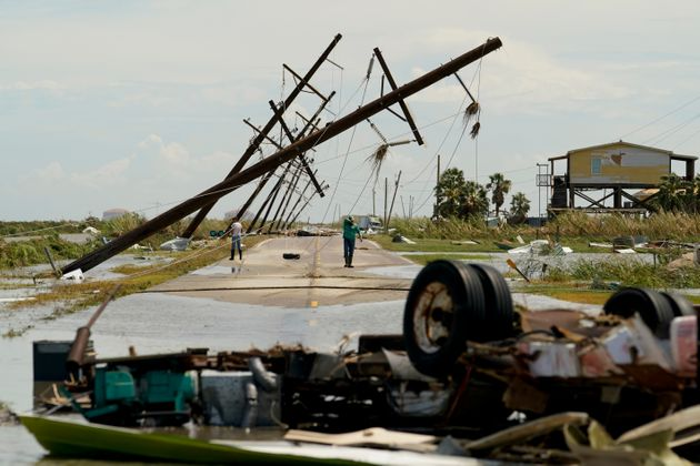 People survey the damage left in the wake of Hurricane Laura on Thursday, August 27, 2020, in Holly Beach, Louisiana.