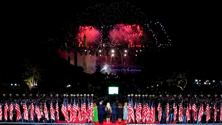 President Donald Trump, first lady Melania Trump and family members stand to watch fireworks after the president delivered hi