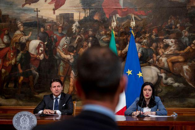 ROME, ITALY - JUNE 26: Italian Prime Minister Giuseppe Conte and Education Minister Lucia Azzolina hold...