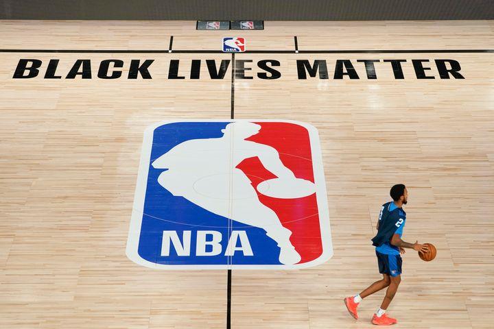 Oklahoma City Thunder's Terrance Ferguson takes the court for practice in an NBA basketball arena on Aug. 28, 2020, in Lake Buena Vista, Florida.