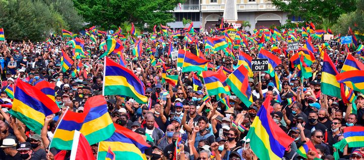Tens of thousands of people protest in Port Louis, Mauritius, Saturday Aug. 29, 2020, over the government's slow response to
