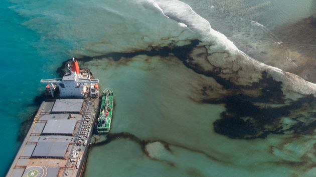 This photo provided by the French Army shows oil leaking from the MV Wakashio, a bulk carrier ship that...