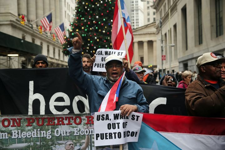Puerto Rican protesters march on Wall Street in New York City in 2015, which activists blame for worsening the island's debt