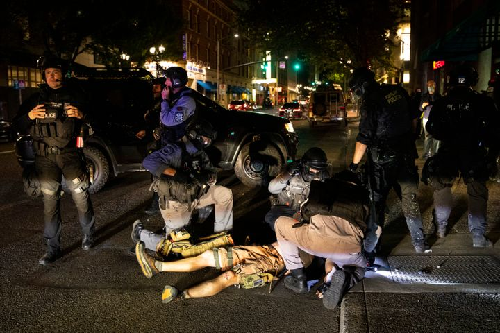 A man is being treated after being shot Saturday, Aug. 29, 2020, in Portland, Ore. Fights broke out in downtown Portland Satu