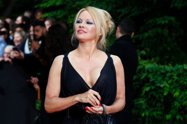 US actress Pamela Anderson arrives with Soccer player Adil Rami at the UNFP (Union of French Professional...