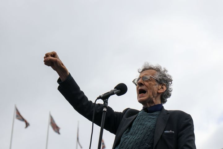 "<strong>Piers Corbyn (brother of former Labour leader Jeremy Corbyn) addresses thousands of Anti mask protesters gather at Tr""/></p> <p> <span aria-label="