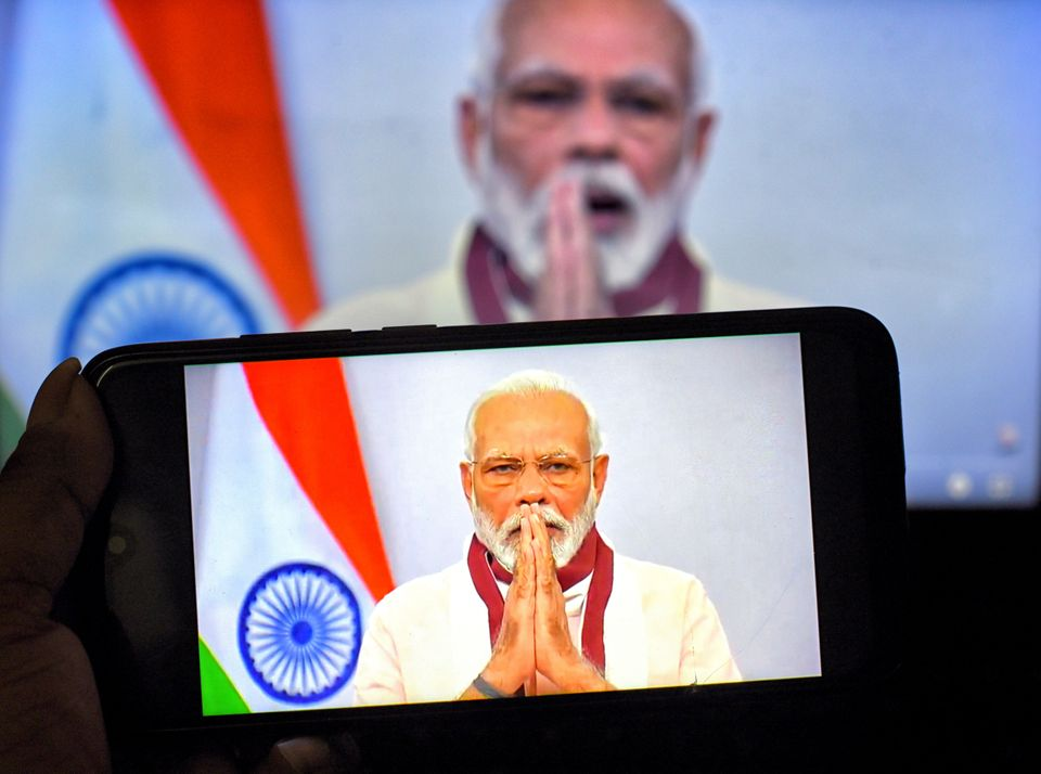 In this photo illustration, Prime Minister Narendra Modi is found speaking to the Nation about Covid19...