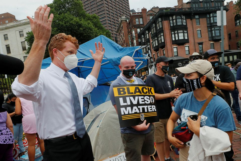 Kennedy talks to workers participating in the nationwide Strike for Black Lives on July