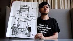 """""""自由""""がギロチンにかけられている…。反逆の風刺画家は、1人になっても香港に残ることを決めた"""