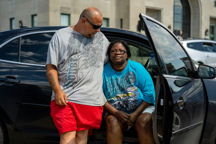 David Frantz and Pamela Elliott wait outside a shelter set up by the American Red Cross at the Veterans Memorial Building in