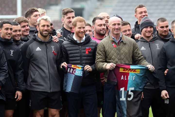 Prince Harry with former Wales rugby captain, Gareth Thomas, right, and Harlequins player Chris Robshaw, left, during a Terrence Higgins Trust event ahead of National HIV Testing Week in London on Nov. 8, 2019.