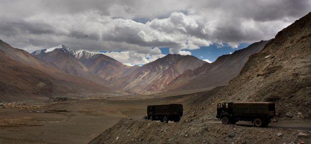 Indian army trucks drive near Pangong Tso lake in Ladakh onSeptember 14,
