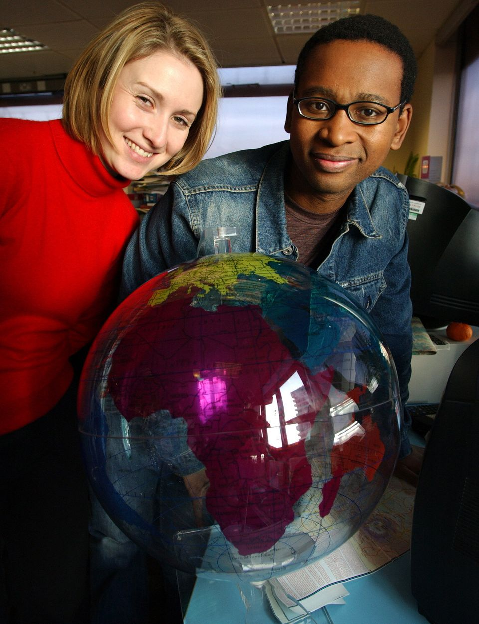 Newsround presenters Laura Jones and Lizo Mzimba pictured in 2003: teachers now using the show in their...