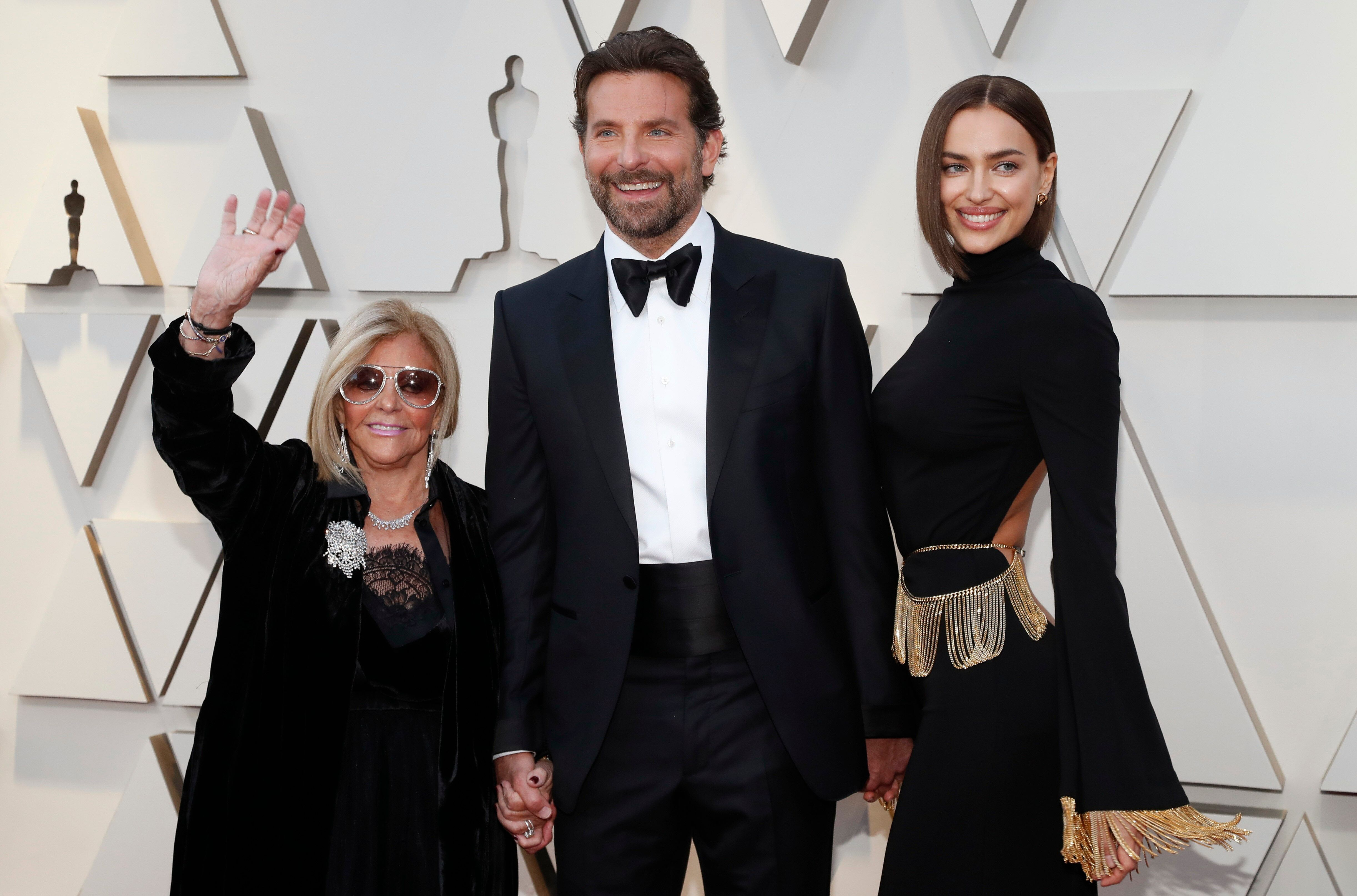 Bradley Cooper arrives with his mother Gloria and Irina Shayk at the 2019 Academy Awards.