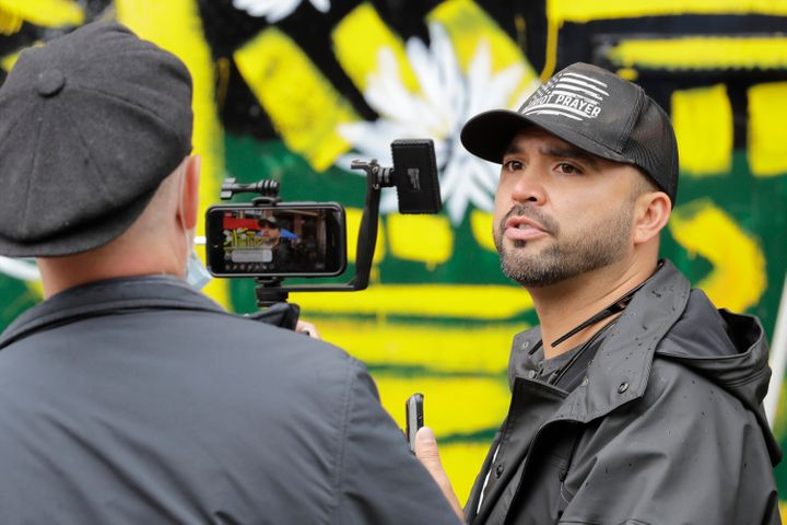 In this June 15, 2020, file photo, Joey Gibson takes part in a live broadcast during a protest in Seattle.Portland shoo