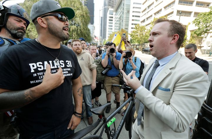 Joey Gibson, left, is the founder of Patriot Prayer. In this August 2018 file photo, he argues with a bystander following a r