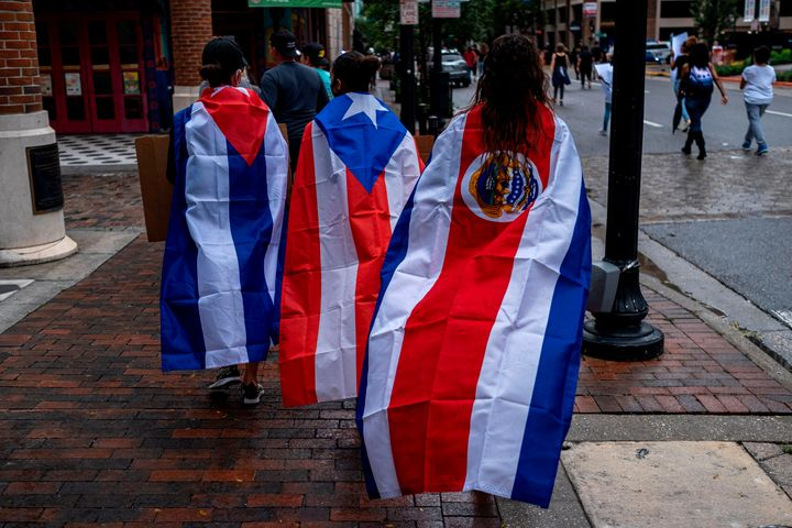 Protesters wear Cuban, Puerto Rican and Costa Rican flags during an anti-racist protest in Orlando, Florida, after the killin