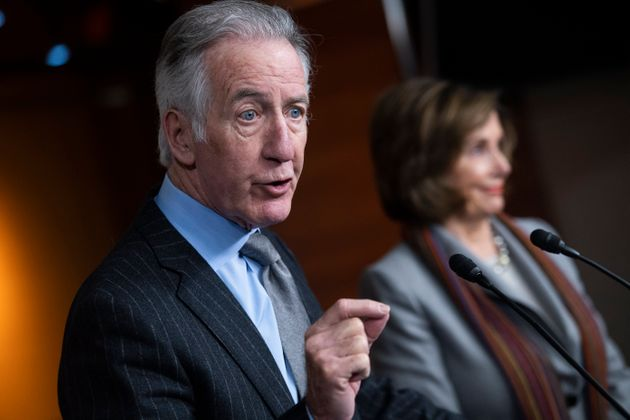 House Ways and Means Chairman Richard Neal (D-Mass.) speaks as his ally, House Speaker Nancy Pelosi (D-Calif.),...